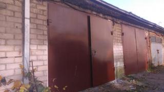 Metaliniai garazo vartai